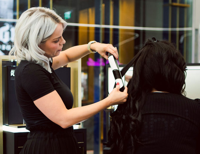a ghd stylist working her magic